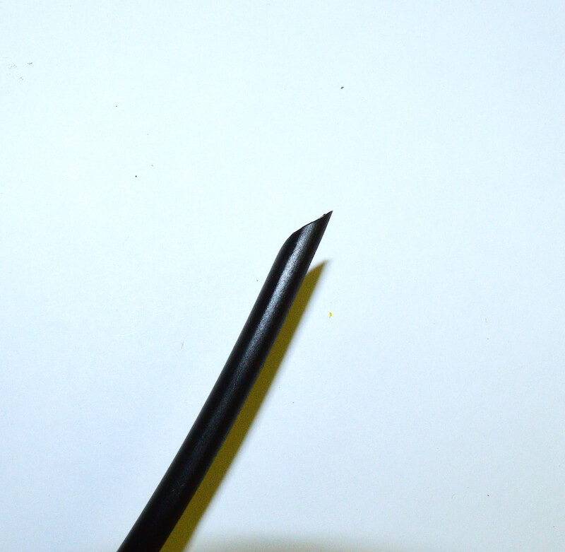 the sharpened end of the tubing